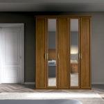 armario de cinco puertas de dos lunas color nogal