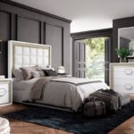dormitorio clásico lacado en blanco con cabecero acolchado